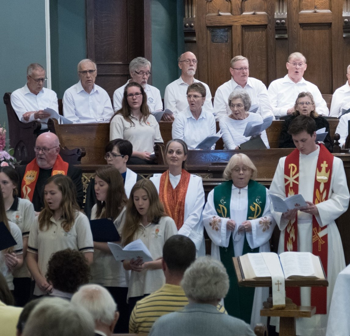 Celebrants in sanctuary after being ordained / readmitted